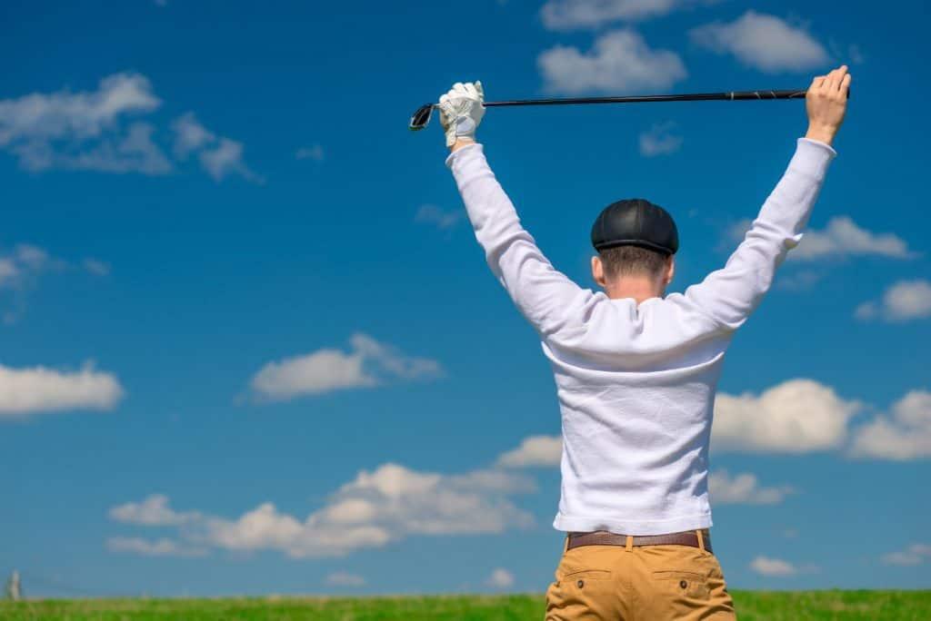 Golf stretch club over head - PG Golf Links